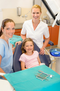Portrait of dental team with young girl in stomatology clinic