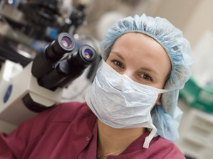 Portrait of embryologist wearing mask in laboratory