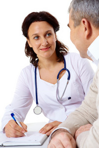 Portrait of friendly therapist looking at senior patient during medical consultation