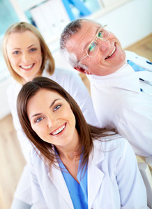 Portrait of group of happy practitioners looking at camera
