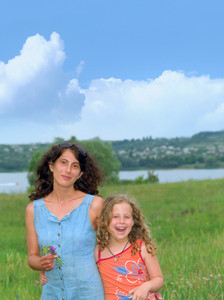Portrait Of Happy Daughter And Her Mother