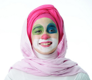 Portrait of happy funny clown kid