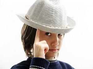 Portrait of happy joyful stylish little boy with hat