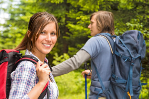 Portrait of hiker girl looking and smiling at camera