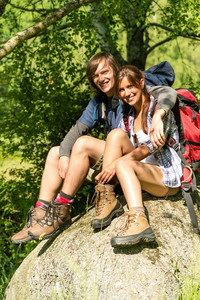 Portrait of hikers young couple outdoors sunny day
