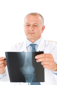 Portrait of hospital professional doctor hold and look at x-ray