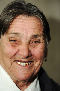 Portrait of laughing elderly woman with golden teeth