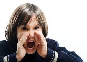 Portrait of little boy shouting