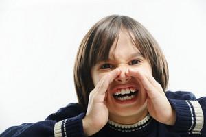 Portrait of little boy yelling