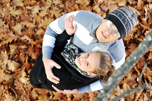 Portrait of love couple embracing outdoor in autumn park