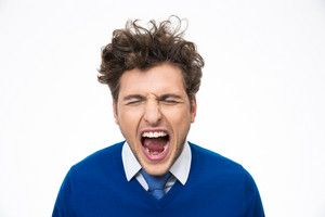Portrait of man shouting over white background