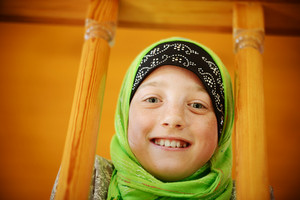 Portrait of Muslim little girl with cute freckles