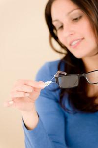 Portrait of optician client choose prescription glasses