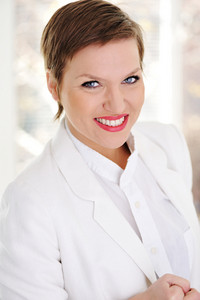 Portrait of positive young business woman smiling