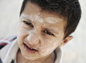 Portrait of poverty, little poor dirty boy, closeup