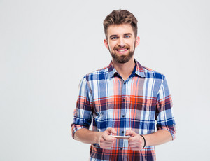 Portrait of smiling man using smartphone