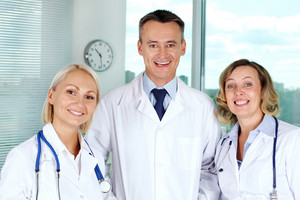Portrait of three successful clinicians looking at camera with smiles