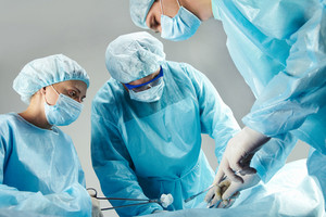 Portrait of three surgeons during operation