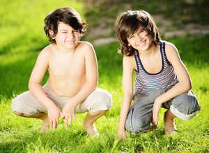 Portrait of two cute kids outdoor in a summer meadow