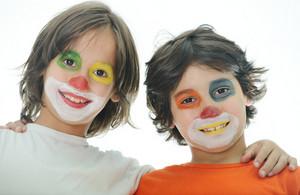 Portrait of two happy funny clown little boys