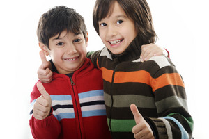 Portrait of two joyful kids isolated on white background