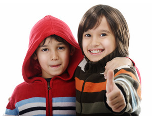 Portrait of two joyful kids isolated on white background