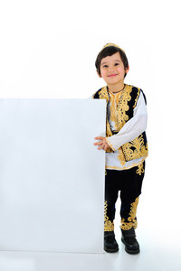 Positive smiling kid holding white banner for your text or picture