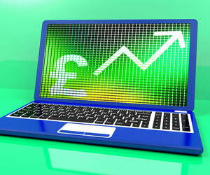 Pound Sign And Up Arrow On Laptop For Earnings Or Profit