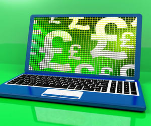Pound Symbols On Computer Showing Money And Investment