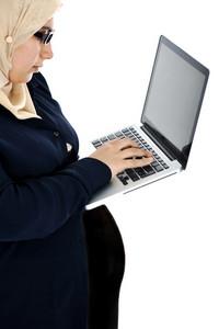 Pregnant Muslim Arabic woman using laptop