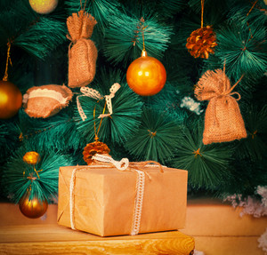 Present against Christmas tree