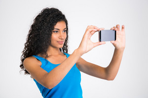 Pretty afro american woman making selfie photo