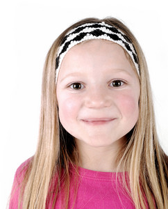 Pretty blonde little girl smiling