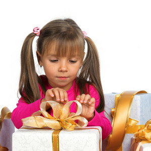 Pretty little girl with present