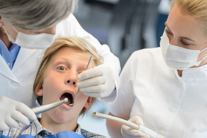 Professional dentist assistant checkup teeth teenager patient boy dental surgery