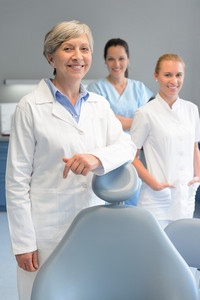 Professional dentist team three woman at dental surgery smiling portrait