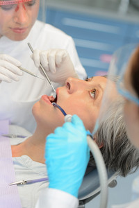 Professional dentists dental checkup senior patient woman open mouth