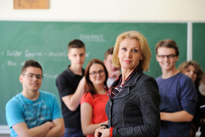 Professor in a classroom with her students