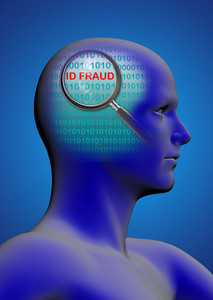 Profile Of A Man With Close Up Of Magnifying Glass On Id Fraud