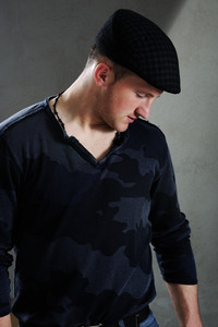 Profile of a young man with a cap