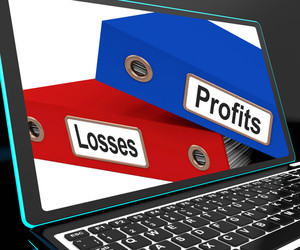 Profit And Looses Files On Laptop Showing Risky Trading