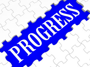 Progress Puzzle Shows Business Growth