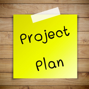 Project plan on sticky paper on Brown wood plank wall texture background