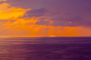 Purple cloudy sunset over sea