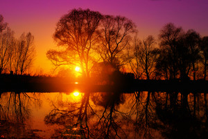 Purple sunset over lake