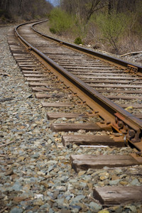 Railroad tracks curving off into the distance ahead.