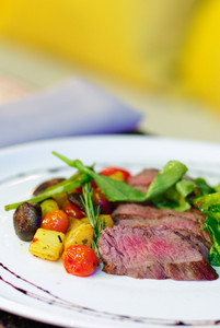 Raw Steak serve on white plate with vegetables