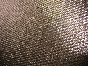 Real carbon fiber in its raw form - this is the material that is used to make durable and strong parts for cars, boats, bikes, and more. Shallow depth of field.