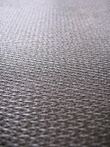 Real carbon fiber in its raw form - this is the material that is used to make durable, strong parts.  Shallow depth of field.