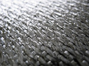 Real carbon fiber in its raw form - ultra shallow depth of field.